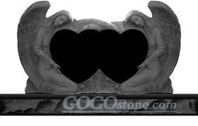Angel Holding Heart Shaped Headstone with Black Granite and White Marble