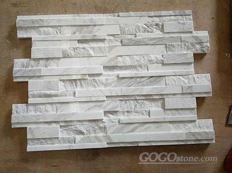 White marble ledger stacked stone panel