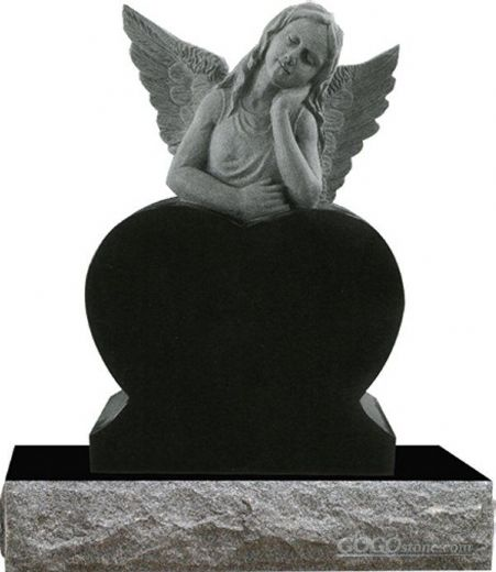 carved stone angel gravestone with wing