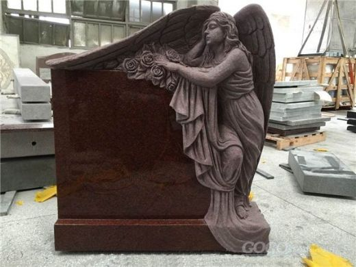 red granite statue carved headstone